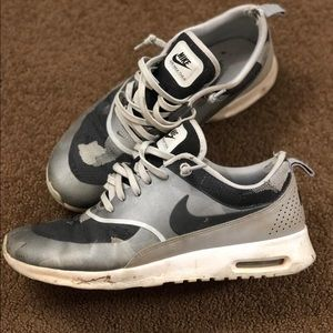 Silver and grey Nike Air Max Thea's